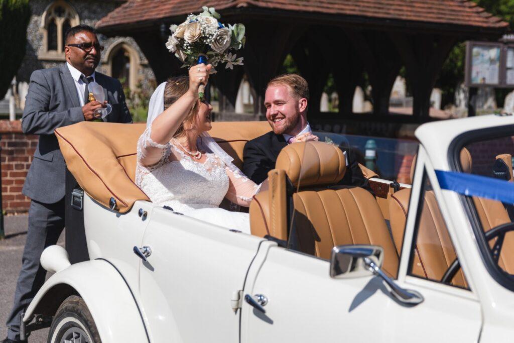 84 bride grooms vintage bridal car departs st marys church winkfield berkshire oxford wedding photographer