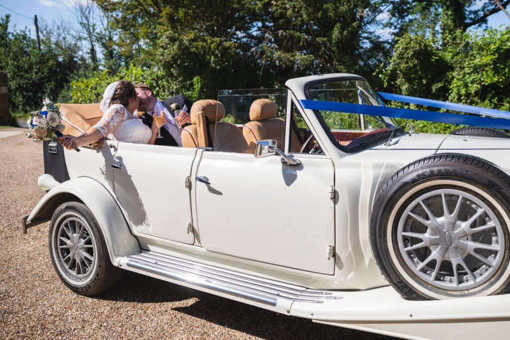 85 bride groom kiss vintage bridal car st marys church winkfield berkshire oxford wedding photography
