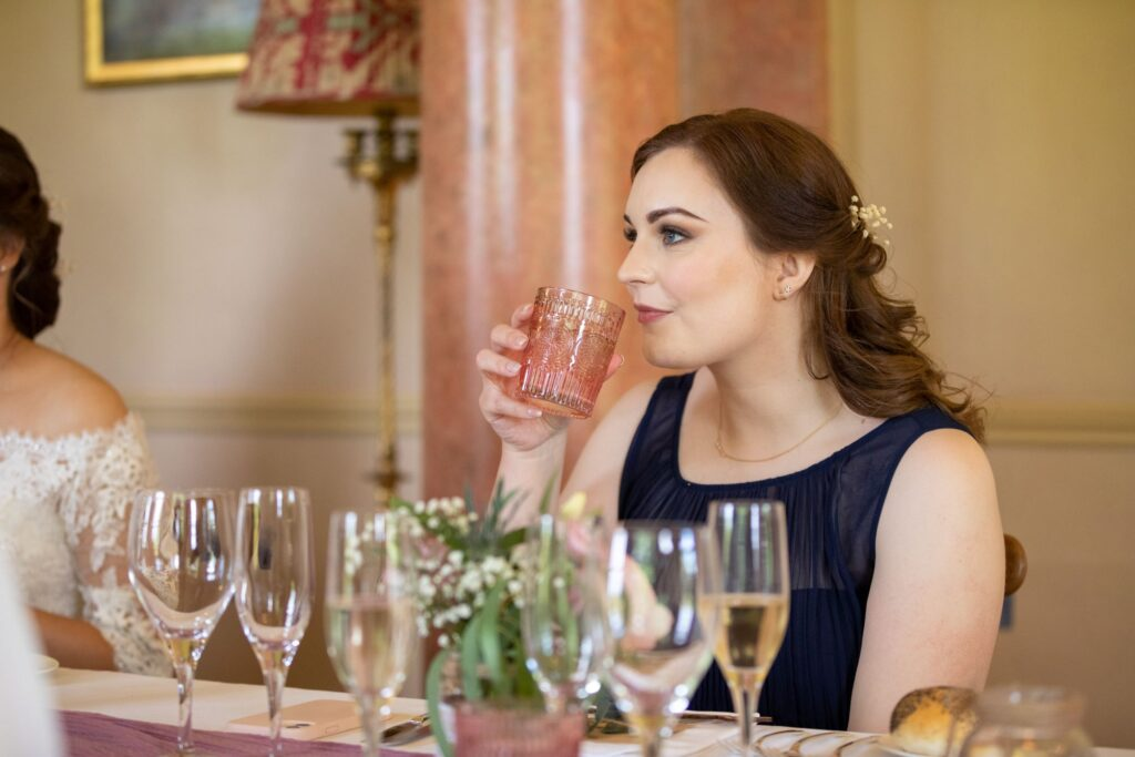 86 bride enjoys drink pauntley court wedding breakfast gloucester oxford wedding photographer
