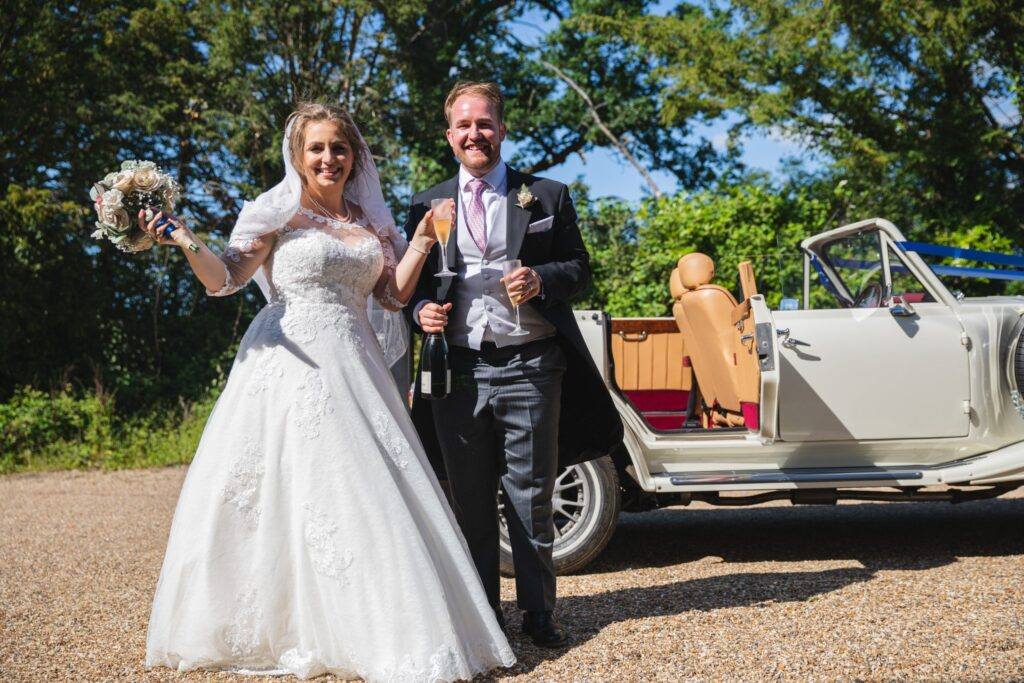 86 bride groom exit vintage bridal car sipping champagne winfield berkshire oxford wedding photographers