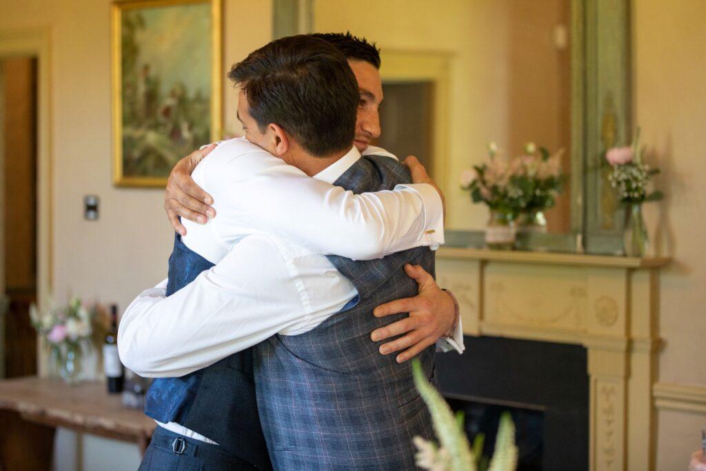 88 groom bestman hug pauntly court reception gloucester oxford wedding photography