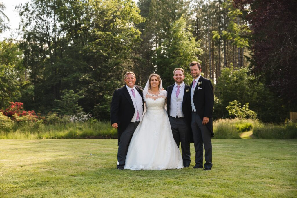 94 bride groomsmen traditional group portrait winkfield garden berkshire oxfordshire wedding photographer