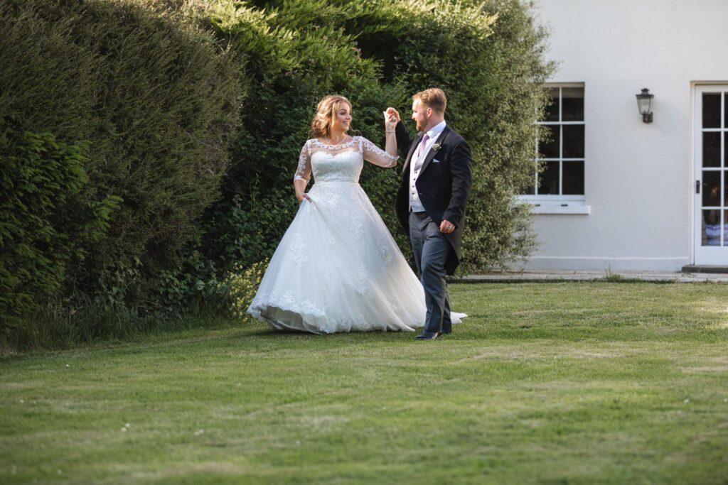 96 bride groom stroll holding hands winkfield garden berkshire oxfordshire wedding photography