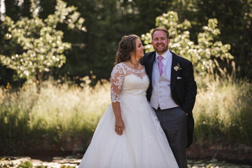97 smiling groom bride enjoy sunset winkfield garden berkshire oxford wedding photographer