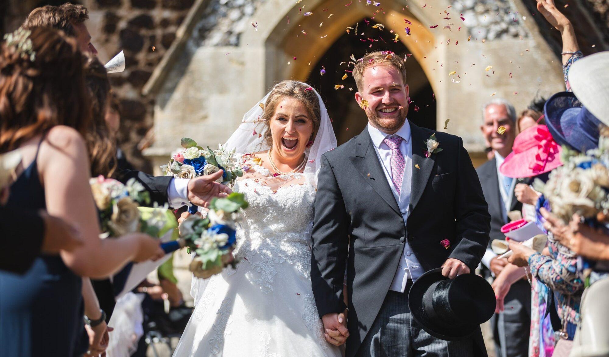 happy bride groom enjoy confetti parade st marys church winkfield berkshire oxfordshire wedding photographers